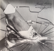 White leather sandal with snakeskin trim (Vogue, Tatler & Ritz magazines, photo by John Swannell)