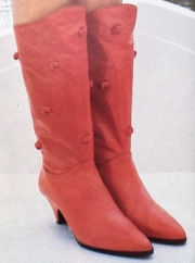 Red leather boots with knots (Vogue & Tatler magazines, photo by John Swannell)