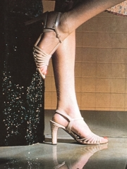 Strappy leather heels with buckle. Medway Shoes. (Vogue & Tatler magazines, photo by Willie Christie, 1980)